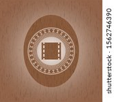 film icon inside wooden emblem