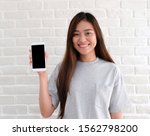 Young Asian Woman Holding Smart ...