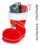 Red Santa's shoe stuffed with Christmas presents over white background - stock photo