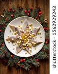 Stock photo christmas herrings fillets with apples pickled cucumbers red onion and spices on a ceramic plate 1562929243
