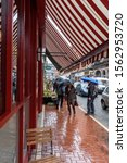 Small photo of EXCHEQUER STREET , DUBLIN, IRELAND- APRIL 2, 2015: People roaming in a rainy day at Exchequer Street in Dublin