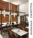 Small photo of CHIANG MAI,THAILAND-APRIL 1,2019:Interior dining space design and architecture of 'KANGSADAN bar and restaurant' decorated with brickwork wall and woodcraft furniture