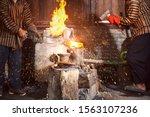 blacksmith forging the molten... | Shutterstock . vector #1563107236
