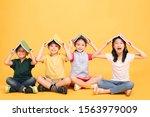 happy children sitting together ... | Shutterstock . vector #1563979009