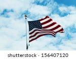 american flag against blue sky | Shutterstock . vector #156407120