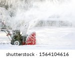 Snow Plow Tractor At Winter...