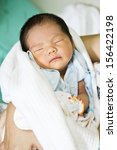 newborn asian baby girl sleeping | Shutterstock . vector #156422198