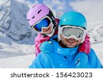 ski  winter  snow  skiers  sun... | Shutterstock . vector #156423023