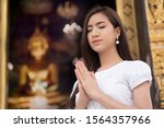 Religious Asian Buddhist Woman...
