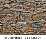 old weathered stone wall background - stock photo