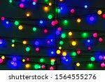 glowing christmas garlands.... | Shutterstock . vector #1564555276