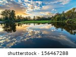 River Reflection Of Clouds Ove...