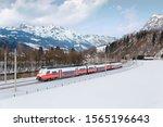 A Train Travels Thru A Railway...