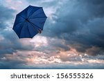 umbrella and cloudy sky closeup | Shutterstock . vector #156555326