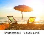 Beach Loungers On Deserted...