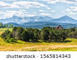 View of San Juan mountains from highway 145 in Colorado with beautiful valley and trees on summer day - stock photo