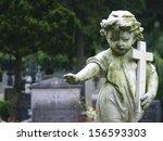 Stone Statue Of A Child Holdin...