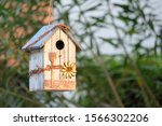 A Bird House Decorated In A...