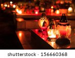 candles burning at a cemetery... | Shutterstock . vector #156660368