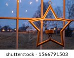 A Star Candle Holder Hanging O...
