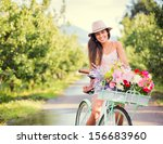 Beautiful Young Woman On Bike...