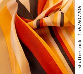 Small photo of Texture, pattern, background, collection, silk fabric, striped fabric, brownish red beige lines, exquisite design.