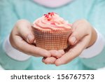 Young Woman Holding A Pink...