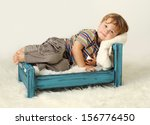 child toddler on bed  awake ... | Shutterstock . vector #156776450