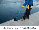 Waterproofing Coating. Worker...