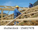 builders working on the roof of ... | Shutterstock . vector #156817478