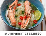 Traditional Thai soup with scampi and noodles - stock photo