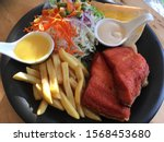fried salmon steak with chips... | Shutterstock . vector #1568453680