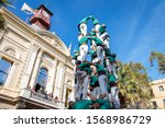 Small photo of Barcelona, Spain - November 10th 2019: Kids Castellers climbing the human tower to reach the top. Performing during the Fiesta Mayor del Clot, an annual celebration.