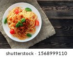 Spaghetti bolognese served on a ...