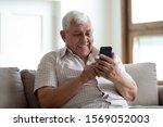 Happy Older Man Sitting On...