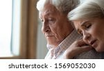 Small photo of Worried middle aged woman embracing upset old man from back, side view head shot close up portrait. Sensitive mature wife showing support, comforting depressed elder husband, experiencing grief.