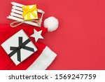 santa claus hat and gift box on ... | Shutterstock . vector #1569247759