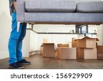 close up of man carrying sofa... | Shutterstock . vector #156929909