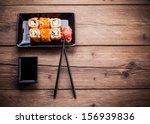 maki sushi set on wooden... | Shutterstock . vector #156939836
