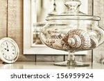 glass jar of beautiful shells... | Shutterstock . vector #156959924