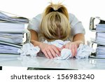 Stock photo a young woman desperately in office between many file folders and crumpled papier symbolfoto for 156983240