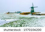 Winter snow windmill farm scene. Windmill winter farm. Winter snow windmill farm landscape. Windmill farm in winter season