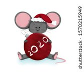 Gray Mouse In A Santa Hat Sits...