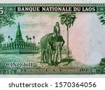 Temple, elephant rider. portrait from Laos 5 Kip 1962 banknote. An Old paper banknote, vintage retro. Famous ancient Banknotes. Laos money. Laos  Banknote. Collection.