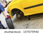 a mechanic looking troubled is... | Shutterstock . vector #157075940