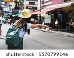 young asian traveler happy... | Shutterstock . vector #1570799146