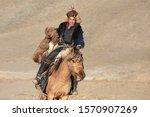 Kazakh Eagle Hunters Partaking...