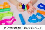 child hands playing with... | Shutterstock . vector #1571127136