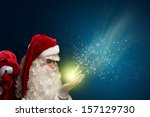 santa claus blows with hands... | Shutterstock . vector #157129730