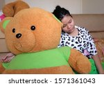 a lonely teen girl cuddles her... | Shutterstock . vector #1571361043